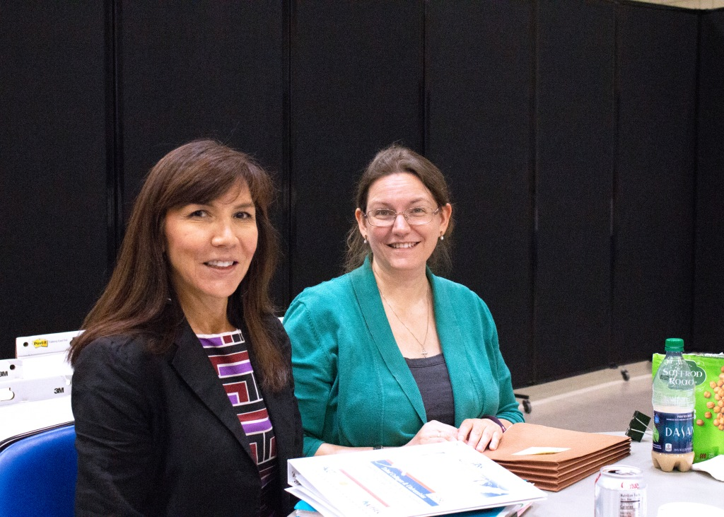AIHEC President & CEO Carrie Billy, left, and Research & Policy Associate Katherine Cardell, observe GISS activities.